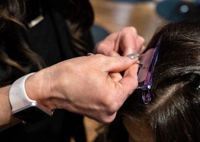 Cura Salon Stylist Applying Hair Extensions